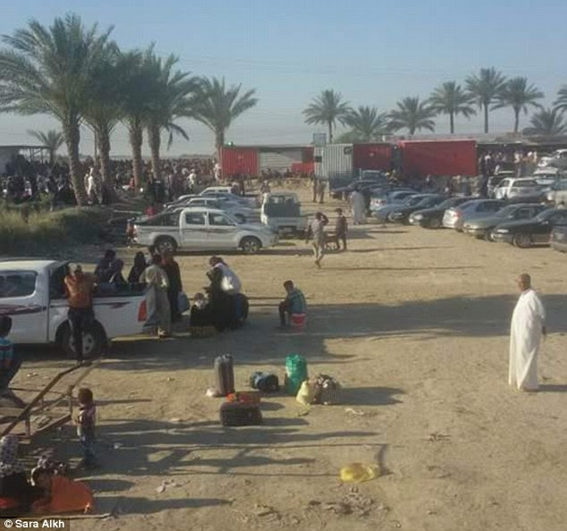 Displaced: Thousands of families are stranded on the outskirts of Baghdad (pictured) after being refused entry into the capital
