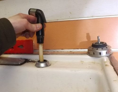 Your kitchen sink spray-wand may be leaking even if you never use it. - Charles Buell Inspections Inc.