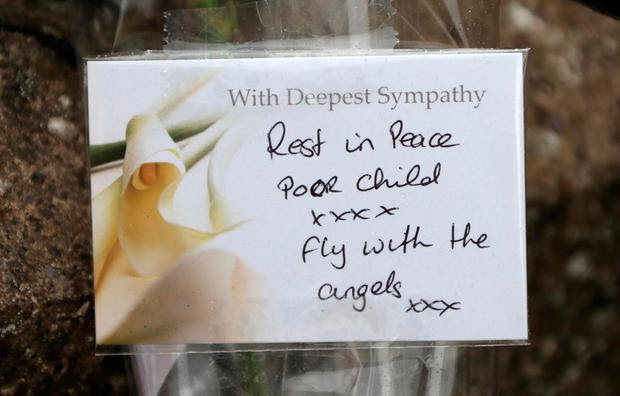 A message on flowers at the Riverside apartment complex, Kimmage where Omar's body was discovered. Photo: Collins
