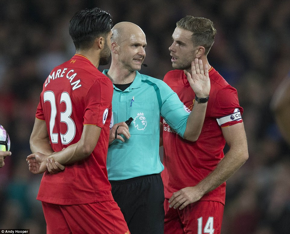 Anthony Taylor was a central figure in the game's build-up and continued to draw Emre Can and Henderson's attention