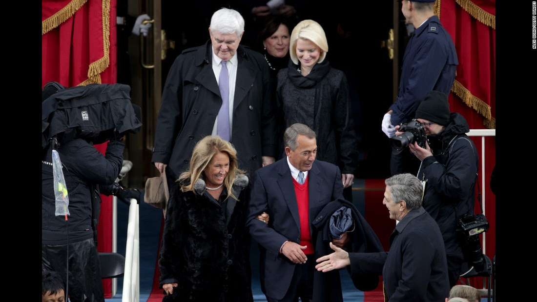 Former House Speakers Newt Gingrich and John Boehner arrive with their wives at the Capitol.