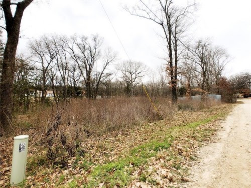Large creek view lot located just down the road fr