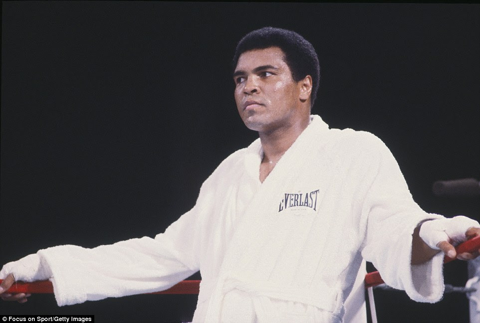Ali, pictured staring down his opponent before a fight, died with his family by his side after a 32-year battle with Parkinson's disease