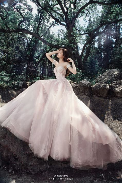 This utterly romantic blush gown from Milva is filled with