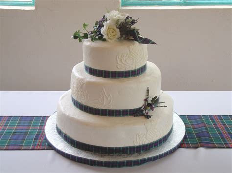Scottish wedding cake   Designs on sides are piped on