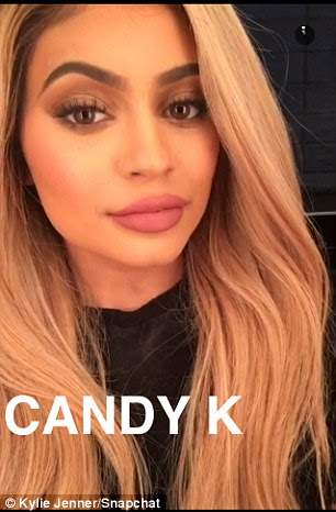Pout and about:The business savvy 18-year-old cast her sultry gaze on the camera while her new blonde locks were seen styled with her light waves