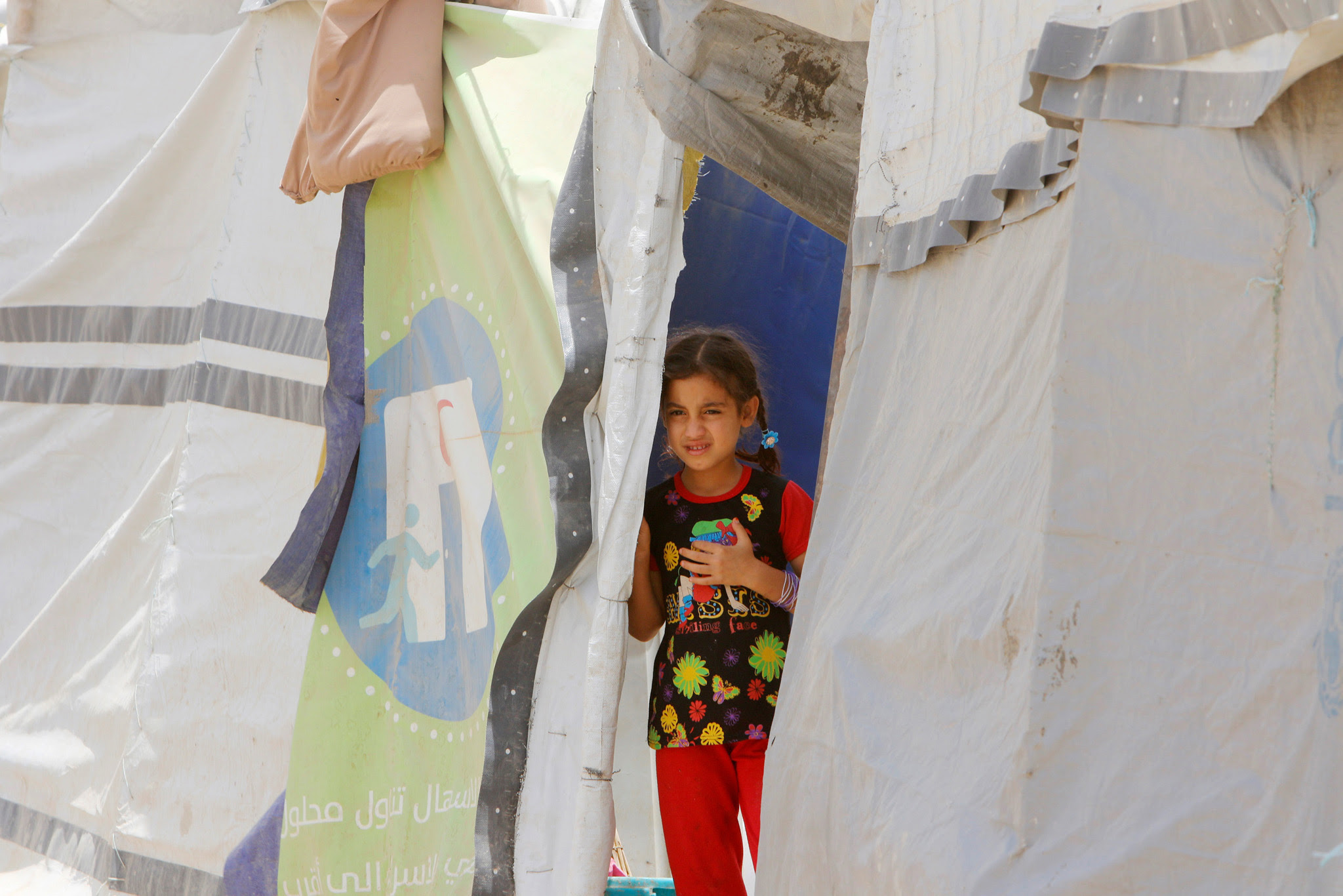 An Iraqi girl who fled from of Islamic State violence, is seen during World Refugee Day celebrations at Al-salam refugee camp in Baghdad, Iraq, June 20, 2016.