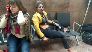 """Two wounded women sit in the airport in Brussels, Belgium, after two explosions rocked the facility on Tuesday, March 22. A subway station in the city <a href=""""http://www.cnn.com/2016/03/24/europe/brussels-investigation/index.html"""" target=""""_blank"""">was also targeted in terrorist attacks</a> that killed at least 30 people and injured hundreds more. Investigators say the suspects belonged to the same ISIS network that was behind the Paris terror attacks in November."""
