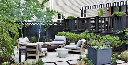 Pavers, Pergola and Black Stain Transform a Chicago Backyard