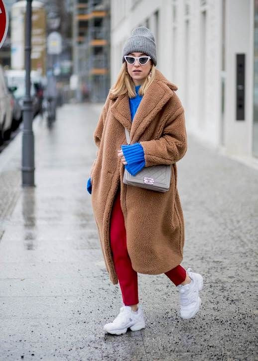 Le Fashion Blog Berlin Fashion Week Grey Beanie Cateye Sunglasses Blue Sweater Brown Teddy Coat Red Cropped Pants White Sneakers Via Harpers Bazaar Au