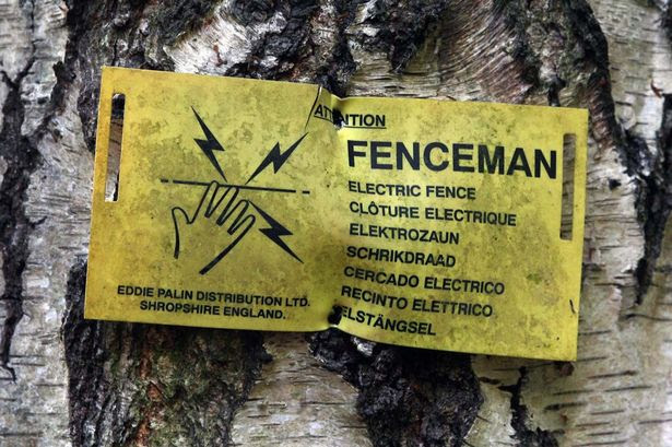 A sign showing the property is protected by an electrified fence