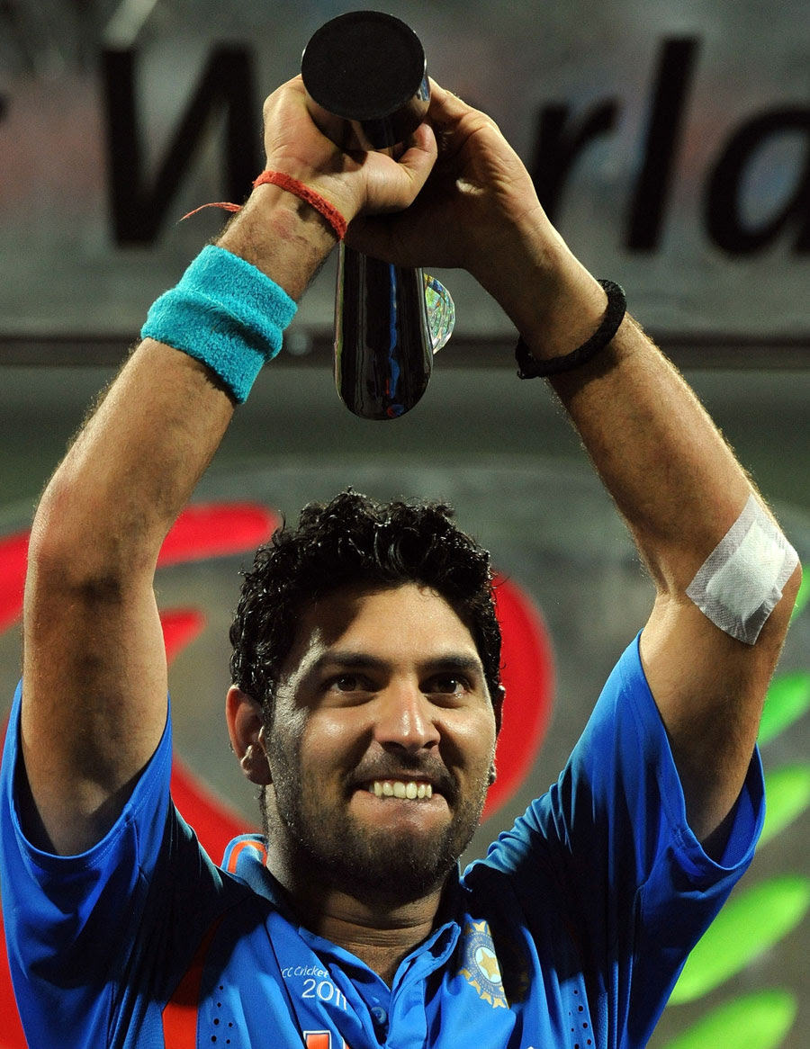 A proud Yuvraj Singh holds the Player of the Tournament trophy