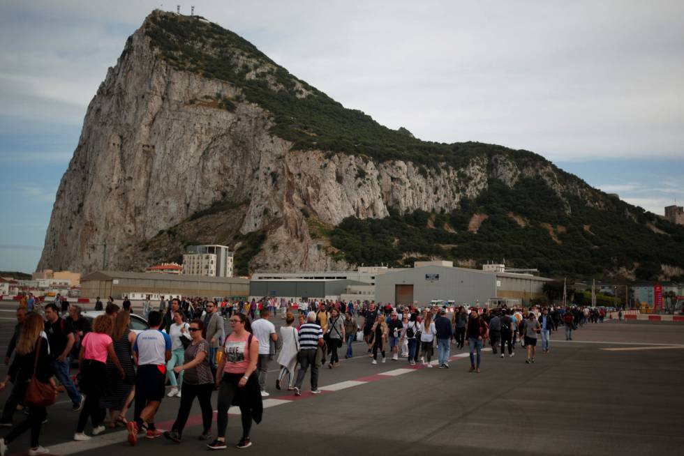 People crossing Gibraltar airport.