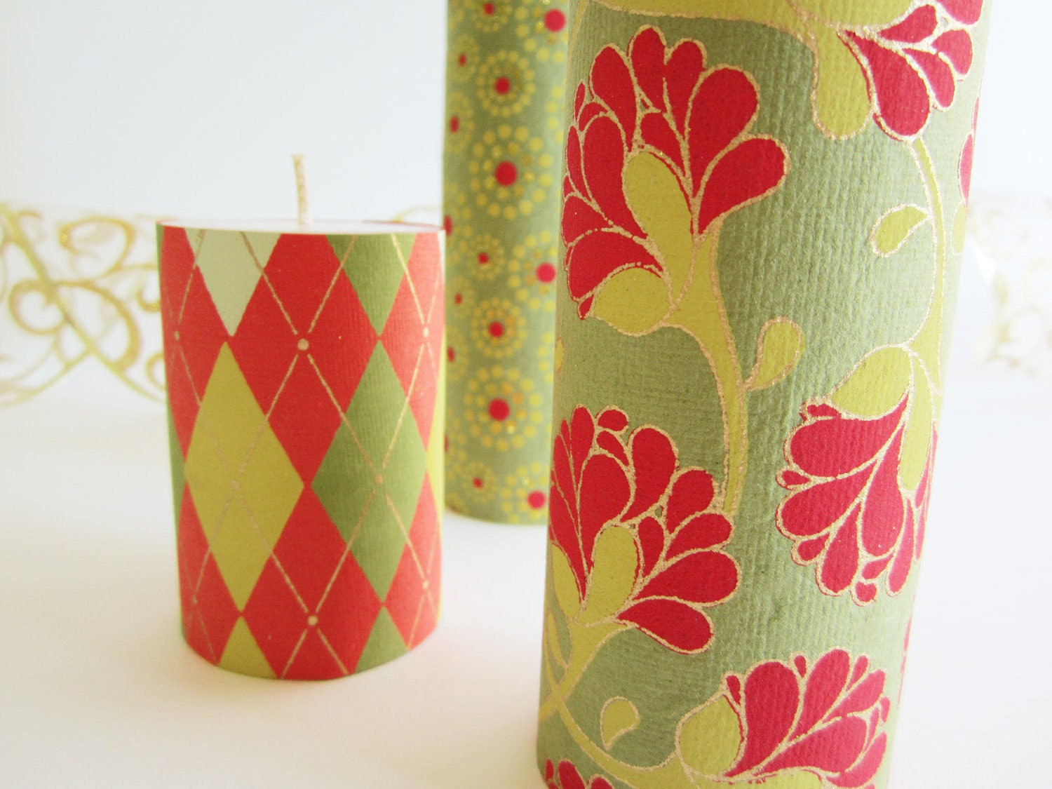 Set of Three Pillar Candles Wrapped and Decorated for the Holidays with Handmade Indian Paper: Argyle, Floral and Concentric Dots on Moss