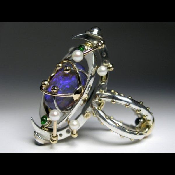 Claudio Pino kinetic ring; 14k gold, 925 silver, black opal, chrome diopsides, emerald, moonstones, pearls.