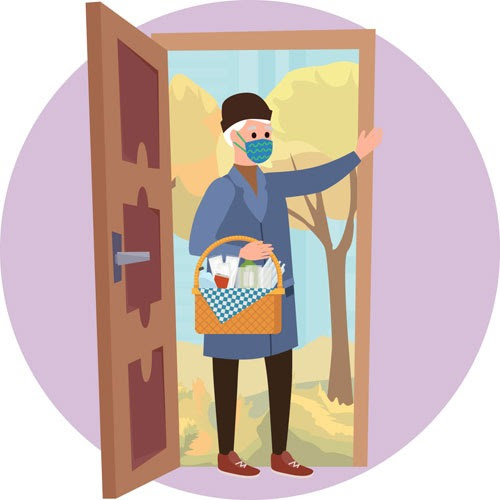 Image of a guest at door with basket of food and wine