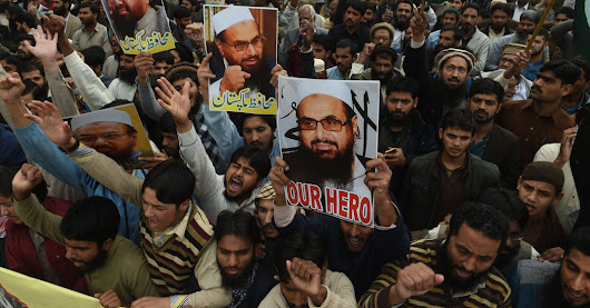 He's on Wanted Posters in U.S., and Campaign Posters in Pakistan