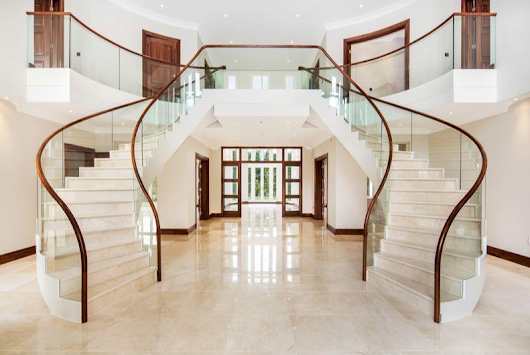 Image: New English marble double stairway with wood and curved glass ...