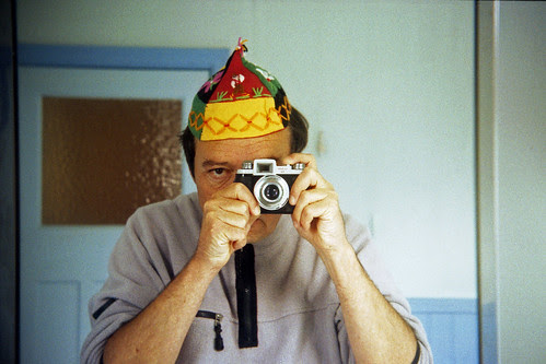 reflected self-portrait with La Belle Pal camera and Madeiran hat by pho-Tony
