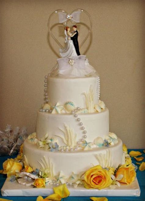 3 tier round white ocean theme wedding cake with shells