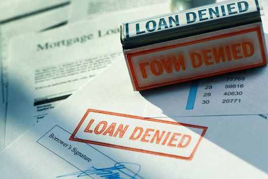 Fannie Mae will ease financial standards for mortgage applicants next month