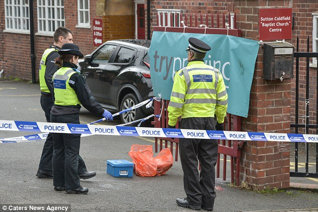 Police officers clean up the scene where a pregnant woman was stabbed in Sutton Coldfield