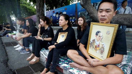 Thais mourn death of revered King Bhumibol Adulyadej - BBC News