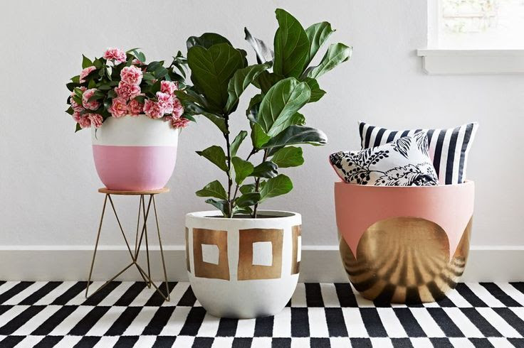 pink, white, and gold painted pots