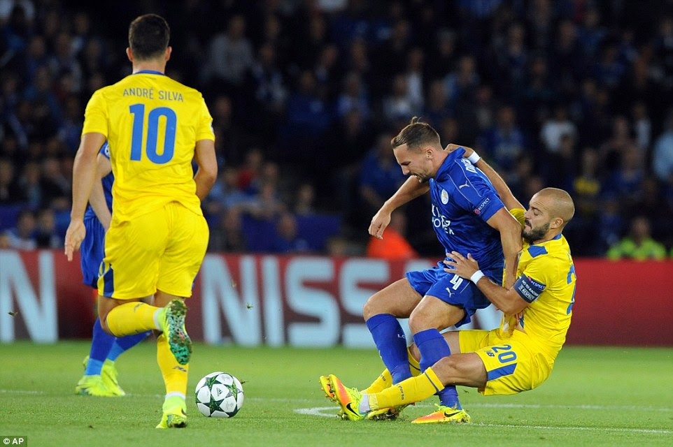 Porto midfielder Andre Andre (right) was fortunate to escape punishment after a rash challenge on Danny Drinkwater