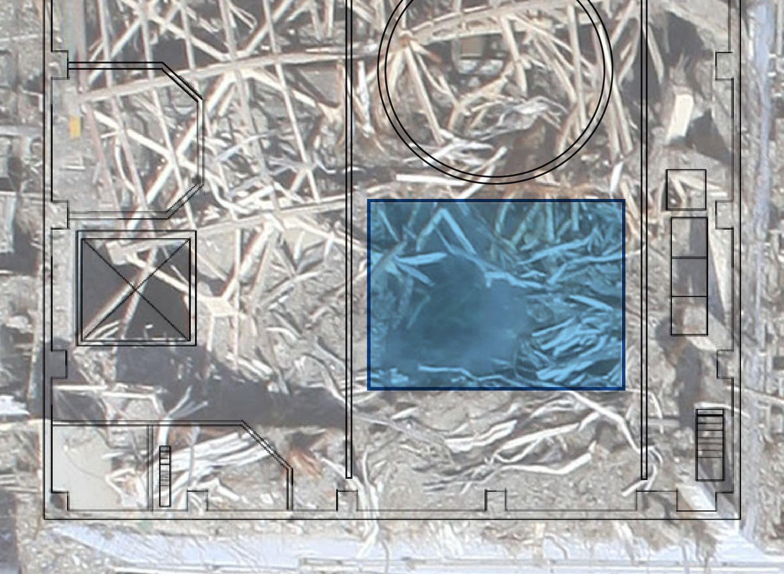 Fig. 34 : Une zone vide de débris est visible dans la piscine de combustible (rectangle bleu)