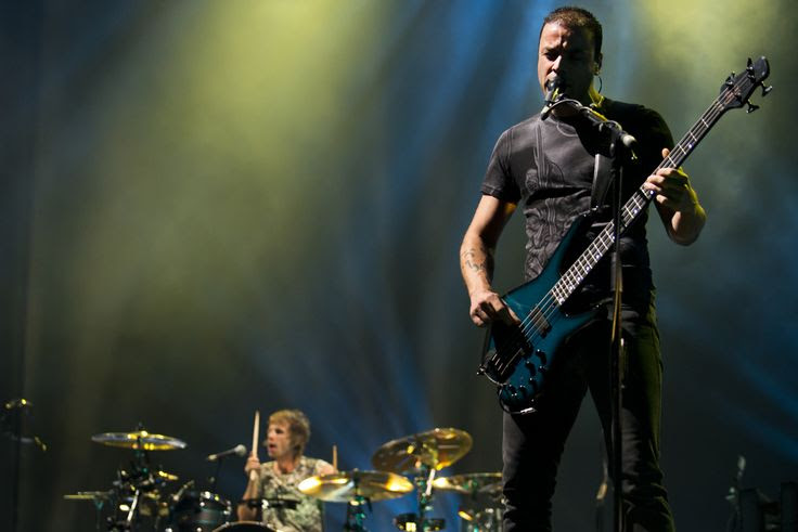 (Molly J. Smith   Special to The Salt Lake Tribune)   Bassist Chris Wolstenholme of Muse performs at the Energy Solutions Arena in Salt Lake City, Utah, on Sept. 20, 2013.