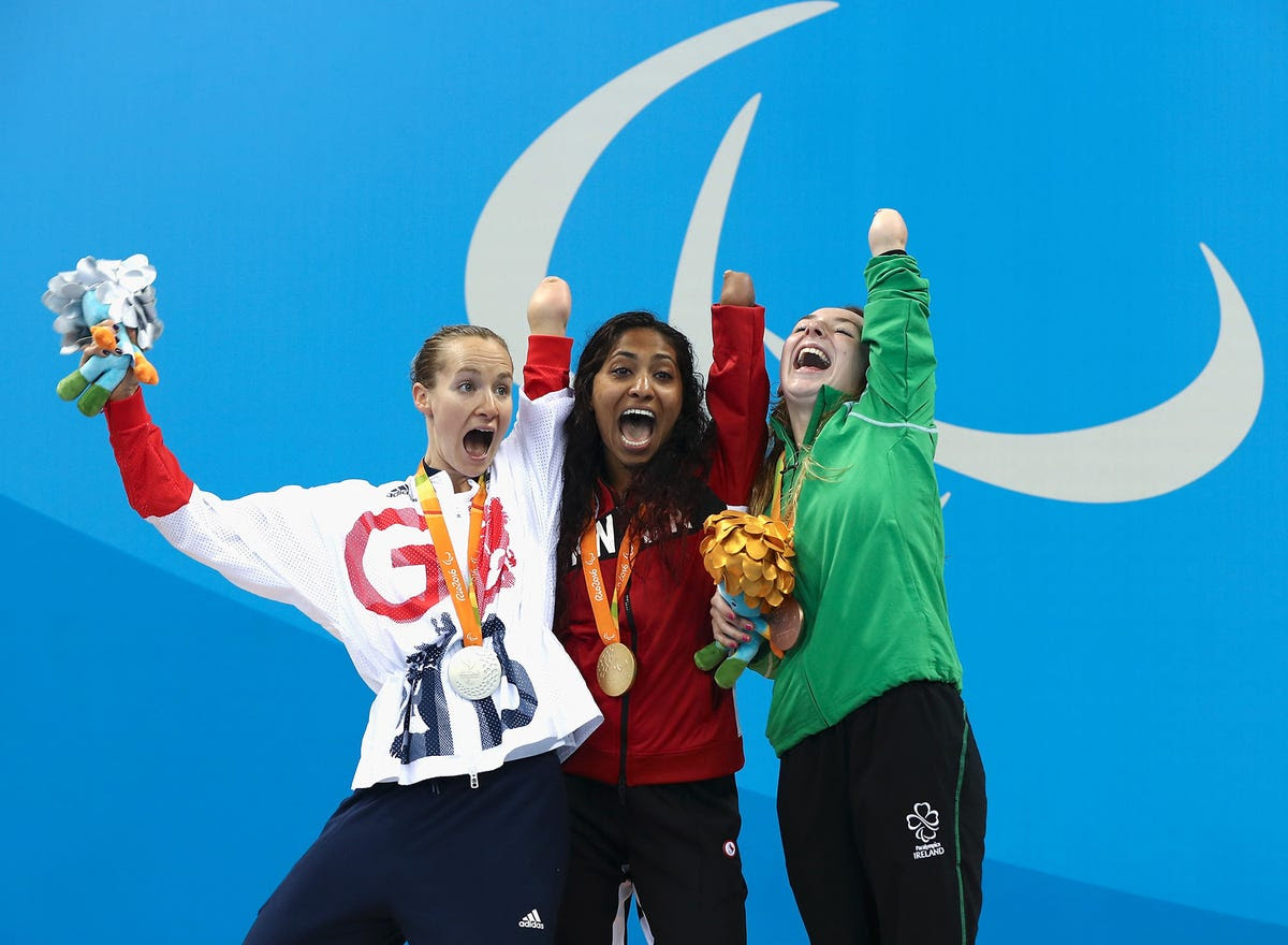 Silver medalist Claire Cashmore of Great Britain (left), gold medalist Katarina Roxon of Canada (center), and bronze medalist Ellen Keane of Ireland (right) celebrate their medals won during the 100-meter breaststroke.