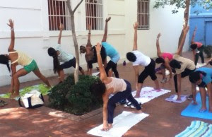 Instructing a yoga class at a Girls' Empowerment Camp in Santa Marta, Colombia.