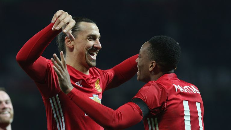 Zlatan Ibrahimovic celebrates with Anthony Martial