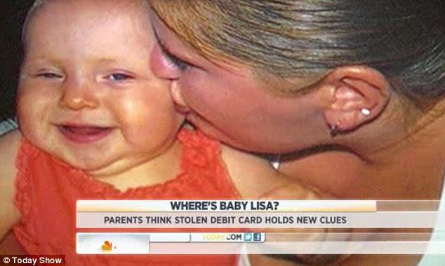 Smiles: Deborah kisses her little girl Lisa before her disappearance in October 2011