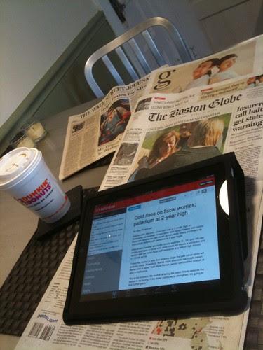 Reading Real Time News on iPad. Unread Newspapers Underneath.