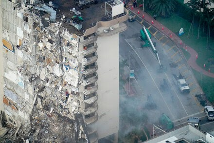 Smoke and debris from collapsed building pose health risks.