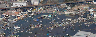 Sendai, in northern Japan, was flooded by Friday's tsunami. (Itsuo Inouye/AP Photo)