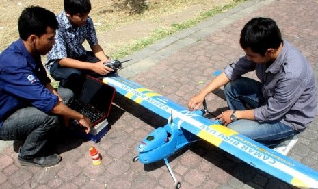 Three students check the unmanned plane, Camar Biru or Blue Seagull, in Yogyakarta on September 25.
