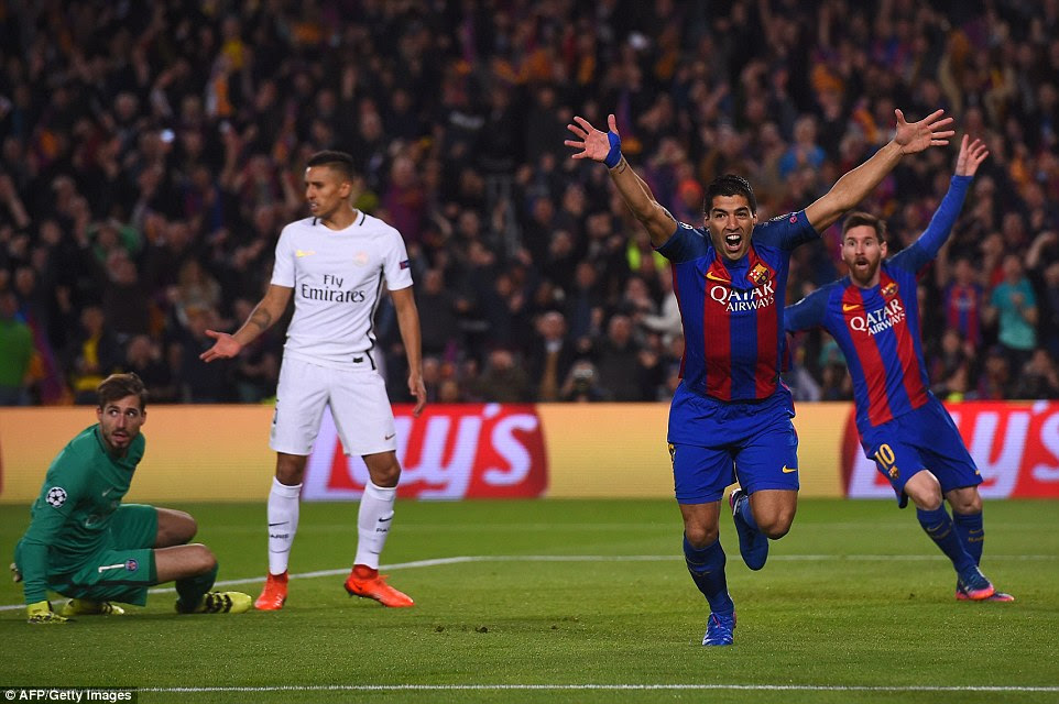 The Uruguayan striker wheels away in celebration after giving Barcelona the perfect start against PSG