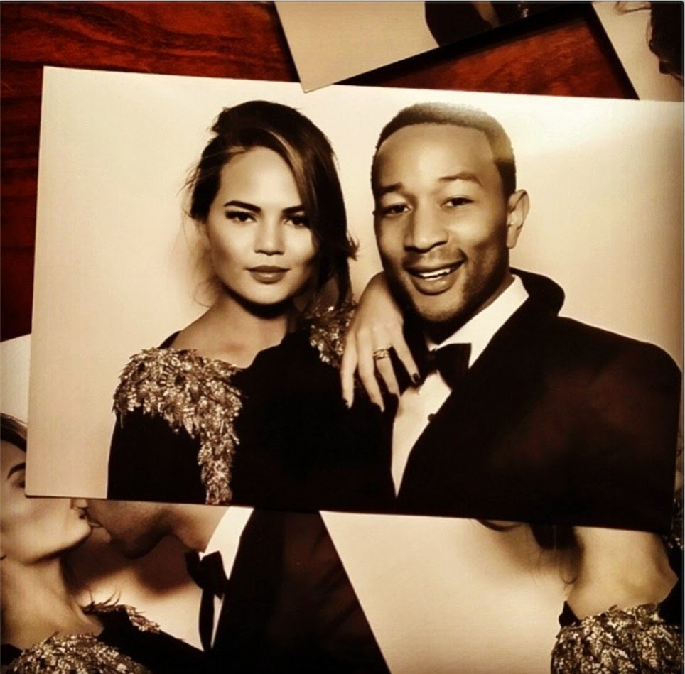 Inside the party! John Legend tweeted a photo booth snap of him and Chrissy Teigen with the caption 'Love, love, love'. And the singer serenaded Kim and Kanye with his song All Of Me for their first dance