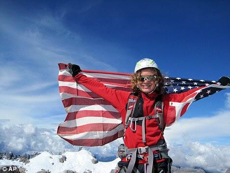 High achiever: Jordan poses at the Carstensz Pyramid summit,  Oceania's highest peak at 16,024 feet