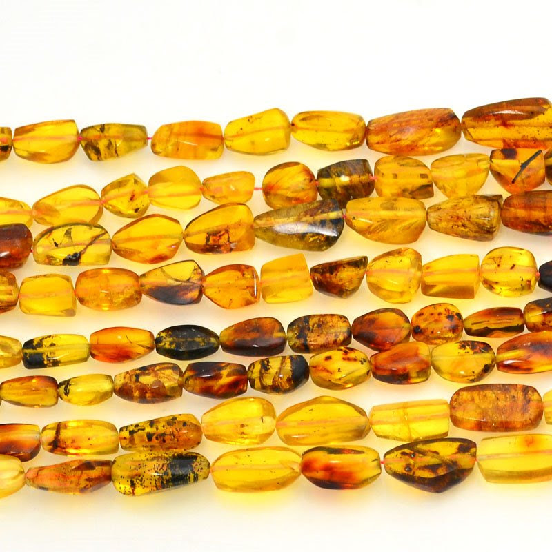 s48719 Amber Beads - Medium Nuggets - Mexican Amber (Strand)