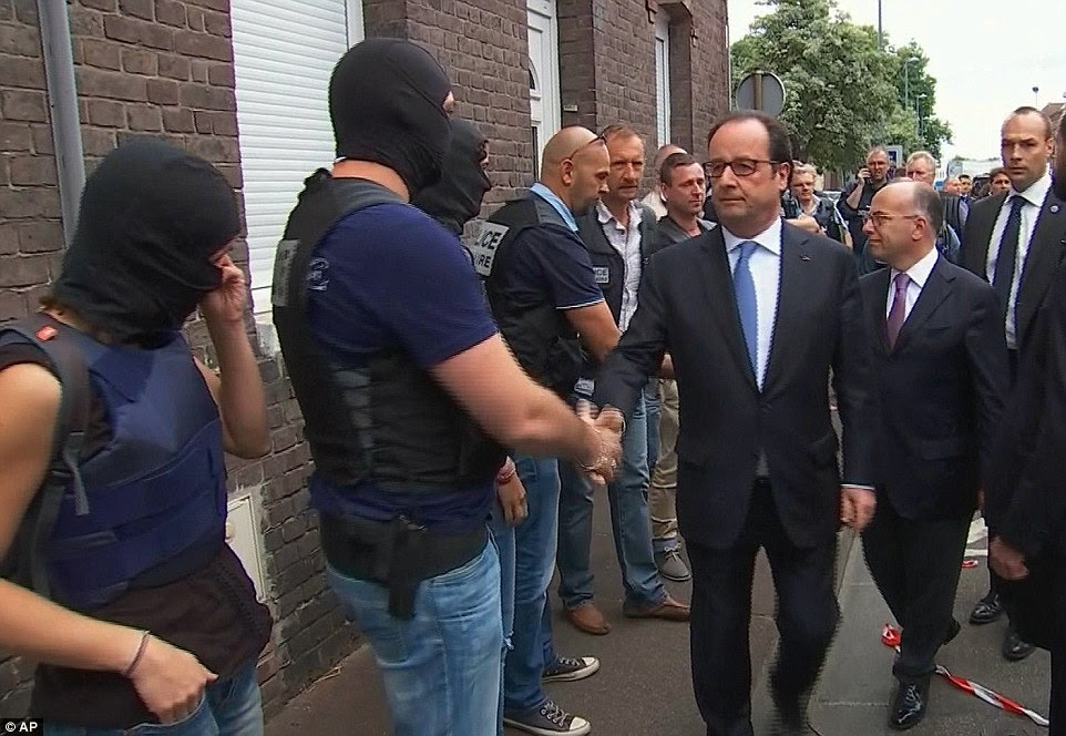 French President Francois Hollande (pictured visiting the scene of the attack today), appealed for 'unity' in France