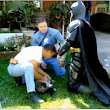Men dressed as Batman, Capt. America rescue cat