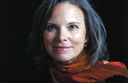 Portrait of Forche, a woman with pale skin, brown eyes, silver hair and wearing a black sweater and red scarf.