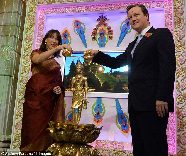 Samantha Cameron's husband David Cameron chose not to dress quite so spectacularly wearing a safe navy suit