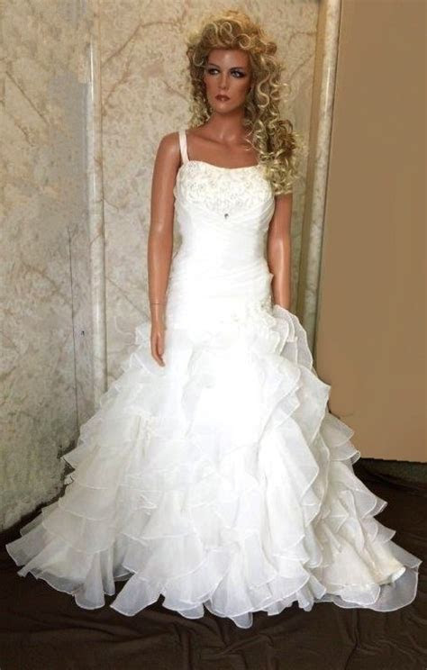 Ruffle wedding dresses. Wedding dress ruffle style gowns.