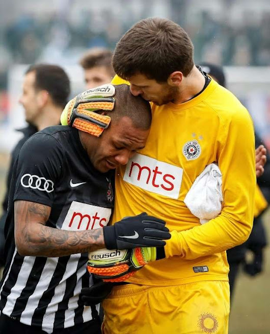 Partizan Belgrade goalkeeper comforts his teammate after he is barraged by racist chants for 90 minutes • r/pics
