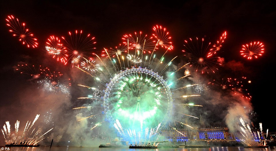 Ambitious: Thousands of people lined the banks of the Thames to witness the incredible display of pyrotechnics and lights